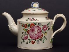 Lot 250 - Creamware Leeds style teapot, circa 1780, painted with flowers in a typical fashion, 4 1/2 ins high