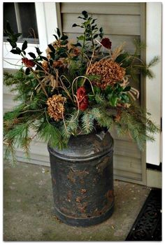 I love this flower display in this antique milk can!