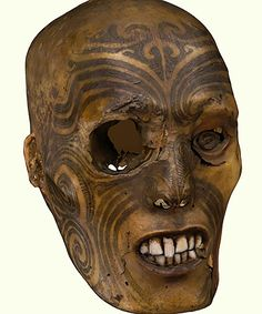 Mokomokai are the preserved, moko tattooed heads of Māori people of New Zealand. The heads of beloved family members, warriors and befallen enemies with moko tattoos were often preserved by removing the brain and eyes of the deceased, boiling then smoking the head and drying it in the sun. The moko tattoo, which symbolizes the Māori's identity, remains vivid through this process and represents the individual after death during sacred ceremonies or as a trophy of war.