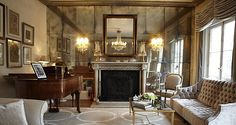 Antiqued mirrored feature wall by Rupert Bevan