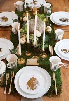 Gather a cluster of pumpkins and gourds - go for a muted palette of greens and grays, intermixed with ivory or cream - in a shallow wire basket or tray on a bed of moss, to complement an otherwise modern setup.