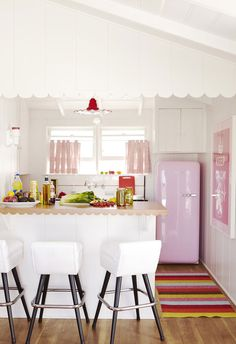 Kitchen with pink appliances.