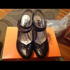 Fiji low heel shoes Adorable,super comfortable low heel shoes. Color on box says metallic black, I describe it as black/bronze color. Fidji Shoes Heels