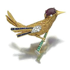 SAPPHIRE, EMERALD, RUBY AND DIAMOND BROOCH, MONTURE CARTIER, CIRCA 1960 Designed as a bird perched on a branch, set with calibré-cut emeralds and diamonds, the wings enhanced with calibré-cut sapphires, circular- and single-cut diamonds, the head set with a cabochon ruby, to the circular-cut diamond eye, signed Monture Cartier and numbered, French assay and maker's marks, case.
