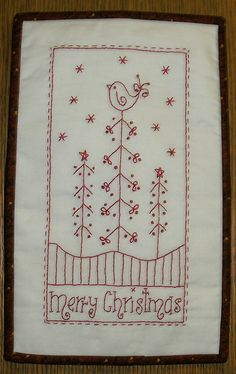 Merry Christmas Stitchery, via Flickr. Would make a great quilt block.