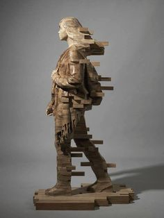 Sculpture By Hsu Tung Han Taiwan SculptureСкульптура - Taiwanese sculpture uses wood to create sculptures of people effected by pixelated glitches