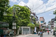 """Yeah, we know. Vo Trong Nghia Architects seems to get all the press when it comes to unique housing design in Vietnam, but for good reason. They're constantly pushing the envelope and seem unafraid of trying new things (that being said, if anyone has recommendations for architecture firms that do the same, let us know. We know they're out there!) and their """"Greenfall Renovation"""" in Hanoi is no exception. ..."""