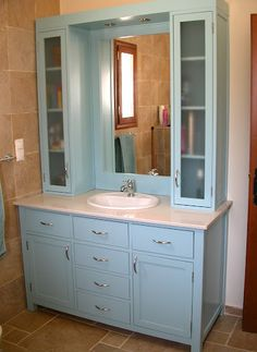 Bathroom vanity with upper cabinets and recessed lights, maybe this would work