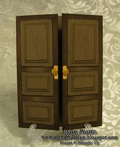 double door with panels...luv all of the details...wood graing, brass door knobs, layers for the panels...