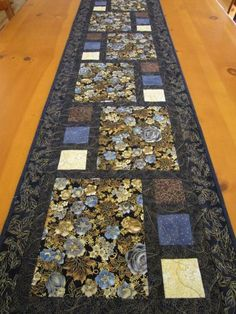 Quilted Table Runner. Good idea for winter animal panels and coordinating fabric