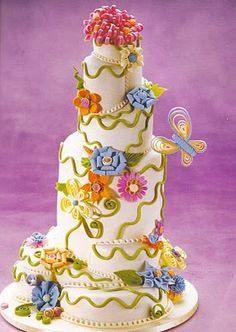 by colette's cakes via cake wrecks.  this is the one i really like: enchanted flora by colette peters