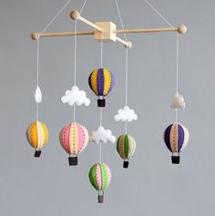 baby mobile - make my own. I like the wood on the top rather than a lot of the circular ones.  But totoro of course hanging down :)