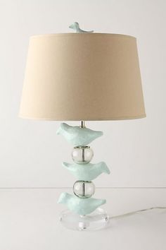 $298.00: A LOT to pay for a lamp, but I think it could be hacked easily enough: DIY papier mache birds, a Target acrylic ball lamp to use for parts, plus the hardware from a lamp store, hardware store, or craft store. SO do-able! @Rowena Murillo, whaddya think?