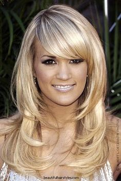 @Erin Lane - this is sorta what I want.  long layers. I want to keep the length and layer my bangs that I sweep to the side  :)