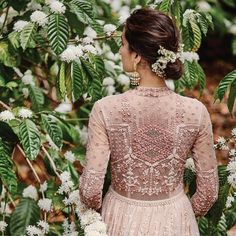 Intricate tonal stories of the forest, are threaded onto fabric. With motifs of flowers, birds, fireflies and trees, our collection is a tribute to the ballads of nature. 'Songs of Summer' by Anita Dongre.