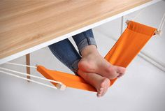 Take my money now! Kick back on casual Fridays while you toil away at endless TPS reports with the foot rest hammock at your desk. This small hammock attaches to each end of the desk and is completely adjustable to fully suit your lounging needs. Take My Money, Cool Inventions, Foot Rest, Office Decor, Desk Office, Work Desk, Office Cubicle, Office Gifts, Work Cubicle Decor