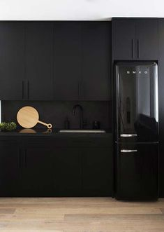 'Blackout' Kitchens Are All the Rage for Good Reason—Here Are 10 to Gawk At - matte black kitchen with polished concrete backsplashes - Black Kitchen Cabinets, Black Kitchens, Home Kitchens, Kitchen Black Appliances, Black And Grey Kitchen, Smeg Kitchen, Black Kitchen Decor, Kitchen Colors, Modern Kitchen Design