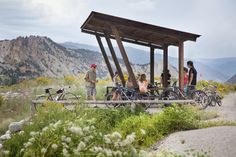Picnic shelter designed with repurposed railroad steel tracks. Located on the Rio Grande Bike path along the Roaring Fork River, Colorado. Land+Shelter: www.landandshelter.com   info@landandshelter.com  © Brent Moss Photography