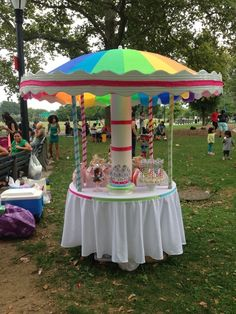 Mary Poppins Carousel.  Big umbrella with some tubing