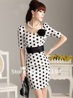 Sophistication. If my waist was that small I'd rock this dress! Workin on it!!!!  I love polka dots!!