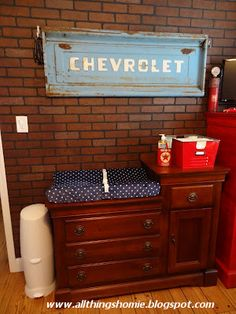 Love the back end of the car over the changing table!  Love this!  Tying in Disney Cars and car antiques for Preston's nursery!