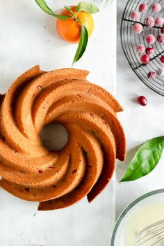 Super festive orange and cranberry bundt cake topped with sugared cranberries. Impress your guests with this beautiful and easy bake! #cranberries #orange #festivebaking #cakerecipes | via @annabanana.co Cranberry Bundt Cake Recipe, Orange Bundt Cake, Cranberry Cake, Orange Recipes, Banana Recipes, Cake Recipes, Glaze For Cake, Sugared Cranberries, Anna Banana