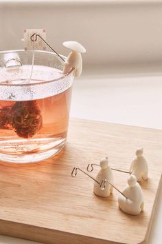 Fishermen tea bag holders, so cute. Could probably make these out of Fimo and wire