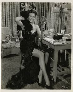 Ann Miller sitting at a vintage Hollywood vanity
