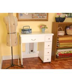Homespun Auntie Em Sewing Machine Cabinet Brand: Homespun Collection: Auntie Includes a universal insert, four drawers and instructions Dimensions: 63.75 x 30.75 x 19.75 inches (W x H x D) (open); 23 x 31.5 x 19.63 inches (W x H x D) (closed); 18.88 x 13.13 x 12.56 inches (W x H x D) (auntie em's opening) Composition: Wood
