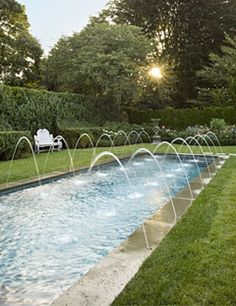 Perfect pool for backyard!  Love the landscaping as well...