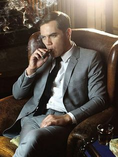 Michael Shannon being devilishly handsome as he casually smokes his cigar while lounging in a classic, wingback chair. Man Smoking, Cigar Smoking, Smoking Celebrities, Michael Shannon, Cigar Men, Leo Men, Modern Gentleman, Dapper Men, Suit And Tie