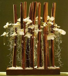 Cinnamon sticks, orchids, Spanish moss