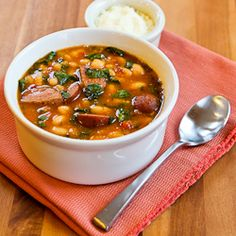 White beans cook all day in the slow cooker and become a stew with Kielbasa, tomatoes, and spinach...