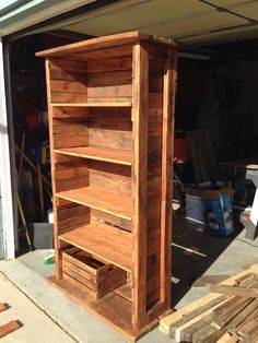 Bookshelf made out of pallets and recycled wood.