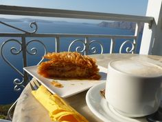 Santorini snack time - baklava and coffee, and the best view in the world.