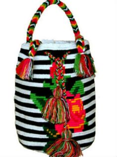 CaritoCaró Wayuu Purse - Ethnic Bo-Ho Chic Fashion The Bag has shades of the Colors: CaritoCaró Wayuu Handbag is an ideal bag for Everyday use, for the Winter or as Summer Beach Bag. This tribal bag is unique and no one else can have the same Bag! Handmade in Colombia. Practical and Colorful.Perfect If you are looking for an exotic gift then you can't go wrong: valentine's gift, mother's day gift, birthday or Christmas gift. Ethnic, Colorful, Fold-able, Durable and Resistant. The ...