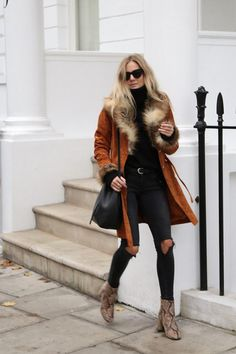 Faux fur, sunglasses and snakeskin boots. Autumn chic at its finest. A black turtle neck long sleeve top keeps it sophisticated with the ripped jeans keeping it a little bit more relaxed.