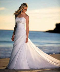 Beautiful dress and also a beautiful picture idea for a beach wedding.