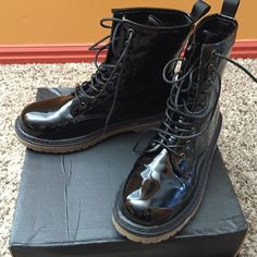 Shiny patent leather black boot. Patent leather striking shiny combat boot with box. Worn once. Shoes