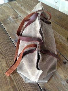 KP#1313 cream coloured suede handbag. adjustable hangers