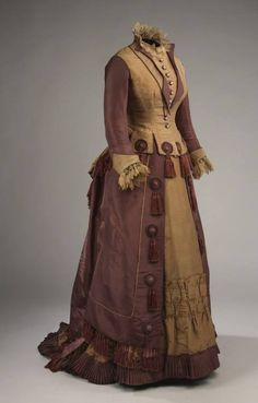 1877 gown from McCord Museum. Interesting use of little medallions with swags all over the skirt and bottom of bodice.