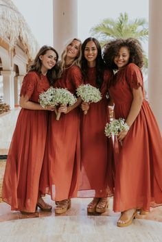 These floor-length bridesmaid dresses are bright and vibrant. See more modest bridesmaid styles in our dress boutique. Fall Wedding Bridesmaids, Red Bridesmaids, Mismatched Bridesmaid Dresses, Burgundy Bridesmaid Dresses, Fall Wedding Dresses, Bohemian Bridesmaid, Bridesmaid Dresses With Sleeves, Bridesmaid Gowns, Luxury Wedding Dress