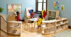 Beautiful art corner - plenty of light, accessible materials, and display of children's artwork.