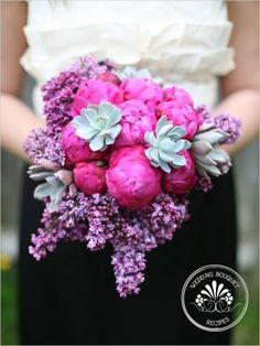 Deep, dark pink peonies enhance the sweet undertones of the lilacs in this abundant bouquet.
