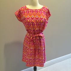 Beautiful boutique dress! Perfect for summer Gorgeous dress worn once bright pink, yellow, orange, & white ikat pattern design dress. Size medium Dresses Midi