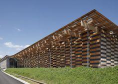 Besançon Art Centre and Cité de la Musique art and culture centre with a chequered timber facade in Besançon, France, by Kengo Kuma.