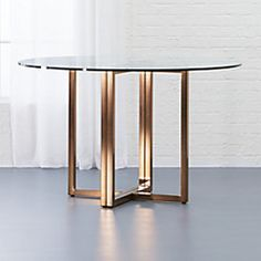 """A gilded update to our popular chrome version. Two sleek brass """"sawhorses"""" partner with crisp, clear glass tops, round or rectangle—your choice. Patio Bar Set, Pub Table Sets, Glass Dining Table, Modern Dining Table, Dining Tables, Small Dining, Gray Dining Chairs, Dining Room Furniture, Gold Furniture"""
