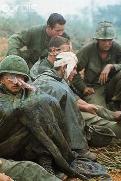 04 Apr 1968, Near Khe Sanh, South Vietnam --- 4/4/1968-Near Khe Sanh, South Vietnam- First Cavalry men, many with head wounds, wait to be evacuated from a hilltop along route #9, during their advance toward Khe Sanh.