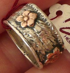 Silver textured handmade band ring decorated by HedvaElanyJewelry, $84.00