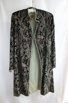 Mariano Fortuny Black Stenciled Velvet jacket. Black velvet stenciled with gold, light green silk lining, Venetian glass beads. (hva)